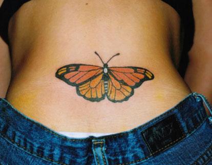 бабочка на пояснице клеймо проститутки