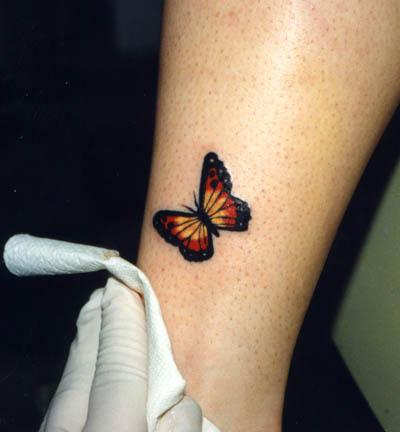 Тату с бабочкой на ноге татуировки